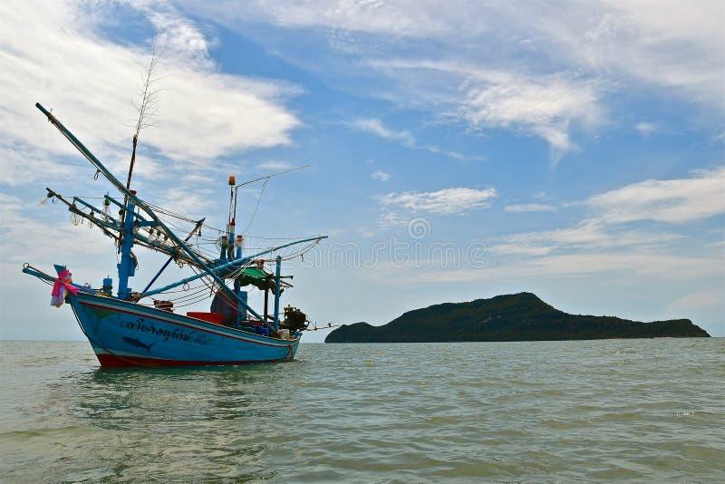 Fishing boat and island stock photo
