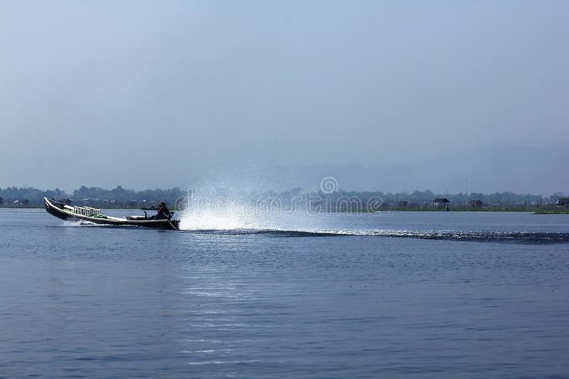 Fishing boat in the lake using speed. Inle Lake is a fishing boat at a speed of travel stock image