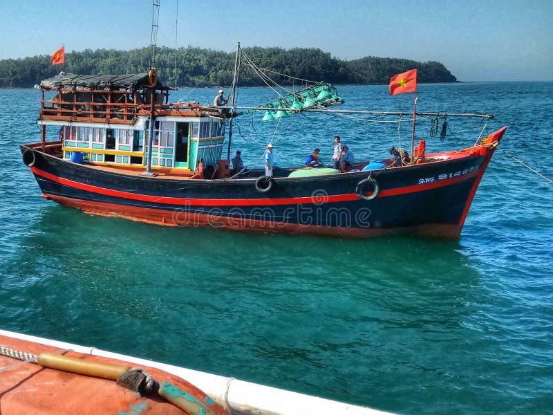 Fishing boat leaving harbor of Quang Ngai, Vietnam royalty free stock photo