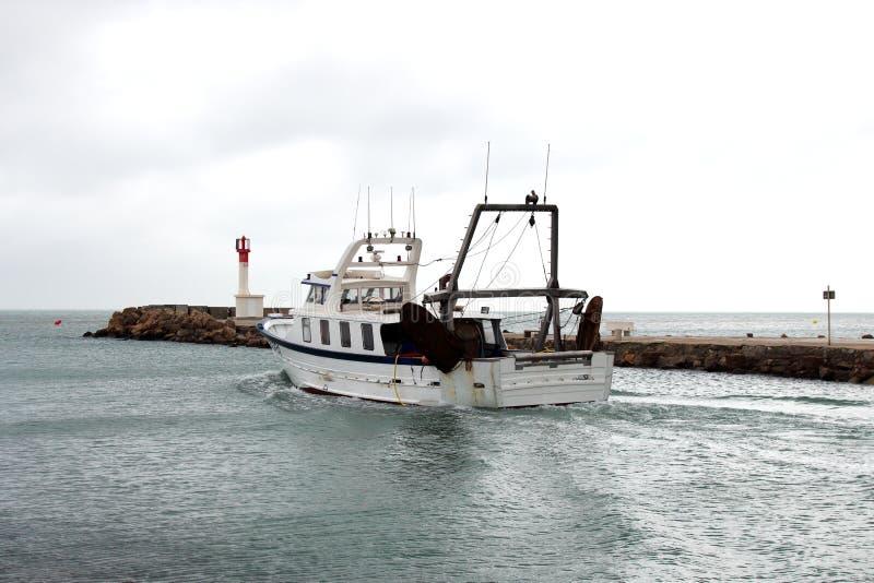 Fishing boat is leaving Le Grau-du-Roi harbour, France stock photo