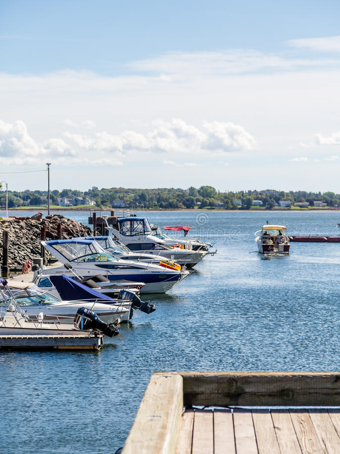 Fishing Boat Leaving Pier. In Charlottetown royalty free stock photography