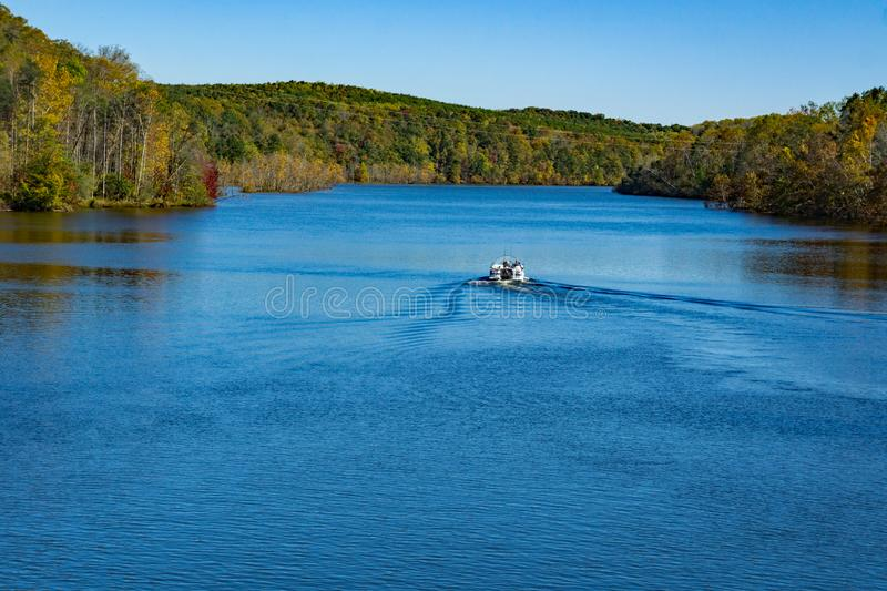 Fishing Boat on Leesville Lake. Leesville Lake, VA, USA on October 23rd, 2019: A pontoon fishing boat on Leesville Lake on a beautiful autumn day located in royalty free stock image