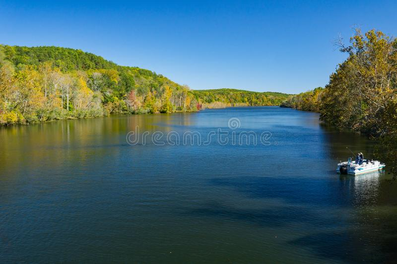 Fishing Boat on Leesville Lake. Leesville Lake, VA, USA on October 23rd, 2019: A pontoon fishing boat on Leesville Lake on a beautiful autumn day located in stock photography