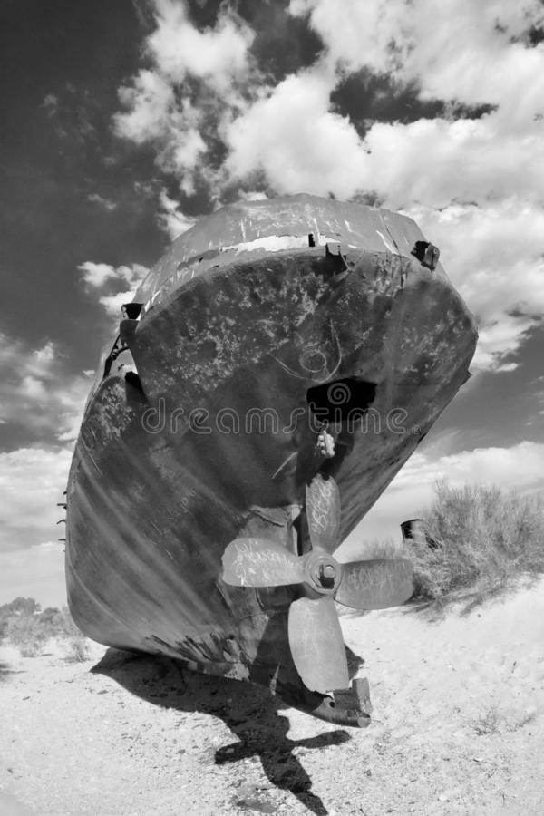Abandoned fishing boat in Aral sea stock photography