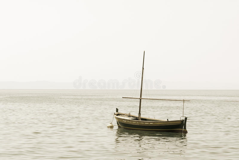 Download Fishing Boat With A Mast In Sea Royalty Free Stock Photography - Image: 26303467
