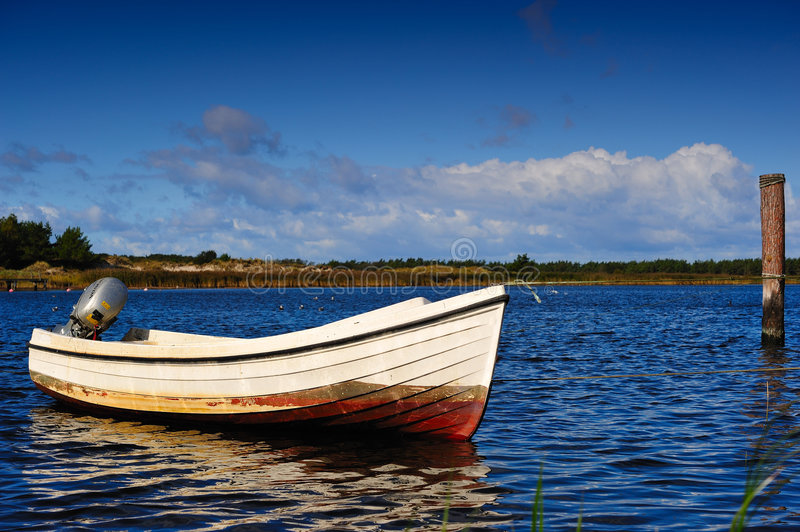 Fishing boat in natural harbor. Small motorboat used for fishing moored in a natural harbor (Darss, Baltic Sea, Germany royalty free stock photos