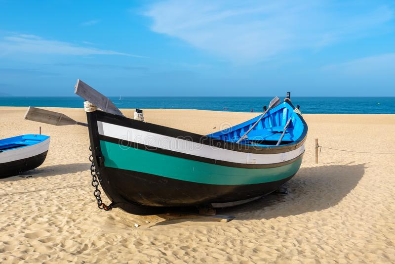 Fishing boat. Nazare, Portugal. Traditional portuguese fishing boat on the beach. Nazare, Portugal stock photography
