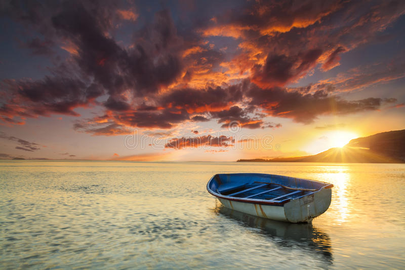 Fishing boat near the shore of the tropical island. royalty free stock photos