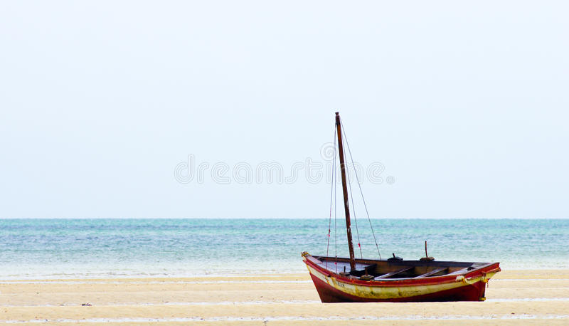 Fishing boat near shoreline stock photo