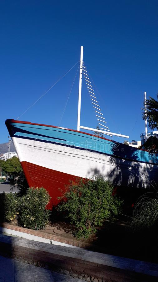 Fishing boat now a maritime museum in a park in Nerja in Andalucia Spain stock photography