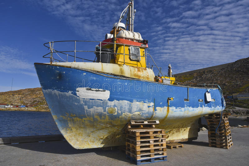 Fishing boat. Old fishing boat parked on land for restoration royalty free stock photo