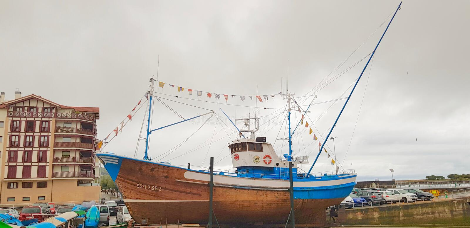 Fishing boat in an old shipyard stock image