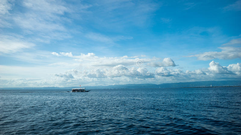 Fishing boat at an open sea royalty free stock photos