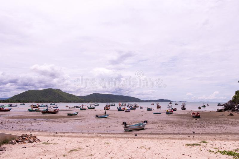 Fishing boat parked on the beach stock photos