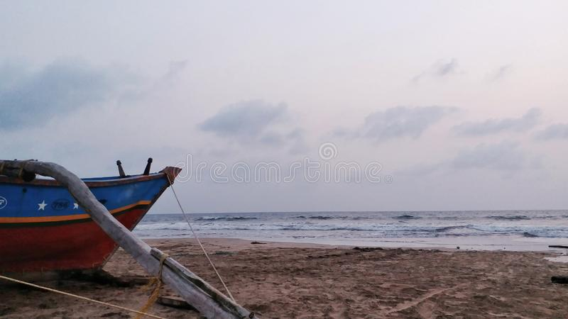 Fishing Boat parked on Beach stock photo