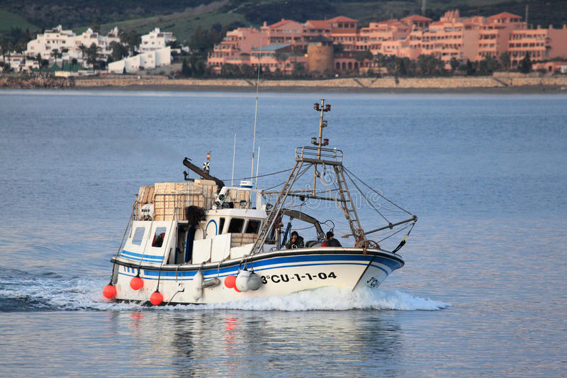 Fishing boat returning home royalty free stock images