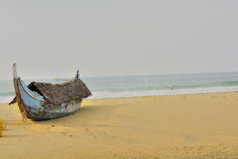 Parked: Fishing boat with a roof - on a beach. Fishing boat with a roof, parked on a beach. Kovalam, Trivandrum, Kerala, India stock photos