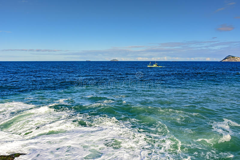 Fishing boat sailing in the waters stock photos
