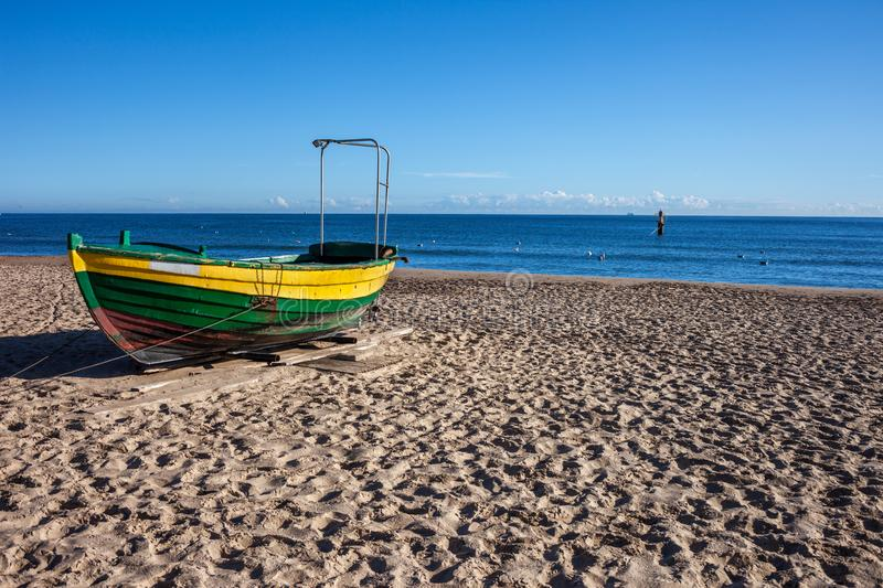 Boat on a Sandy Beach at Baltic Sea in Poland stock image