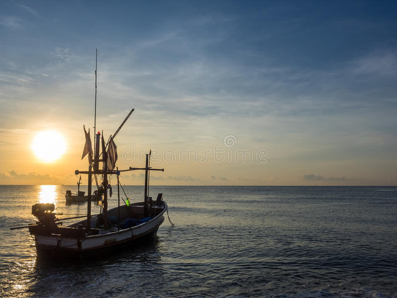 The fishing boat on the sea in the morning. stock images