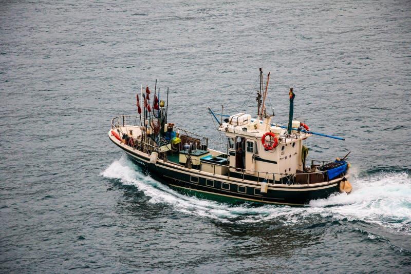Fishing boat in the sea. San Sebastian, Spain stock photography