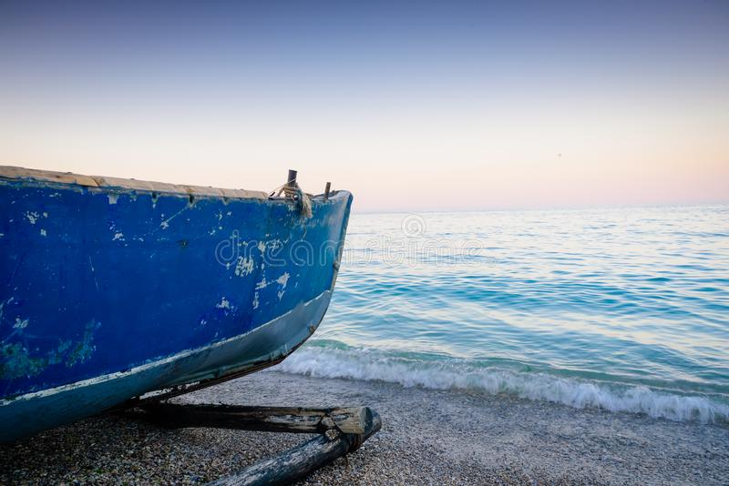 Fishing boat on the sea side royalty free stock photos