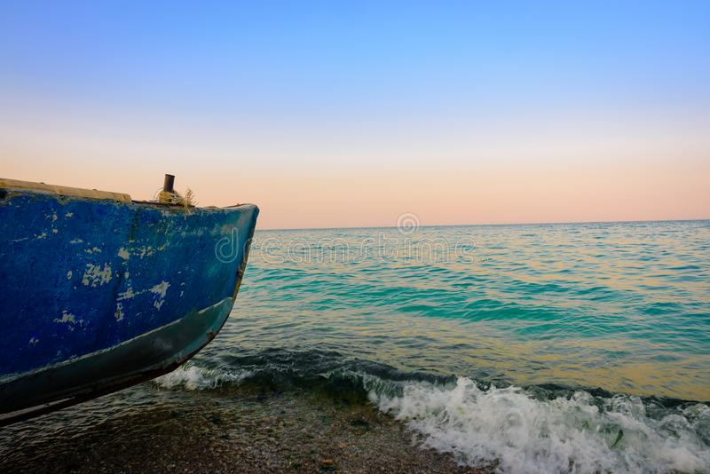 Fishing boat on the sea side royalty free stock photography