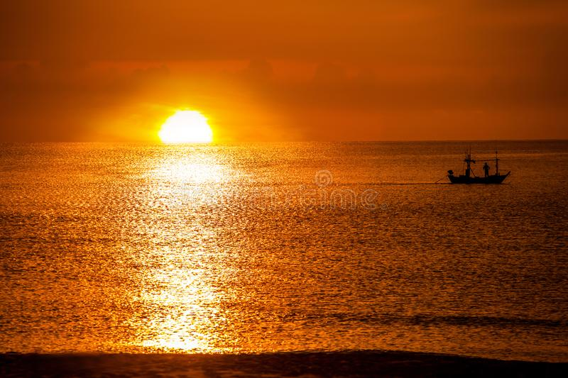 Fishing Boat in the sea and sunrise in morning royalty free stock photos
