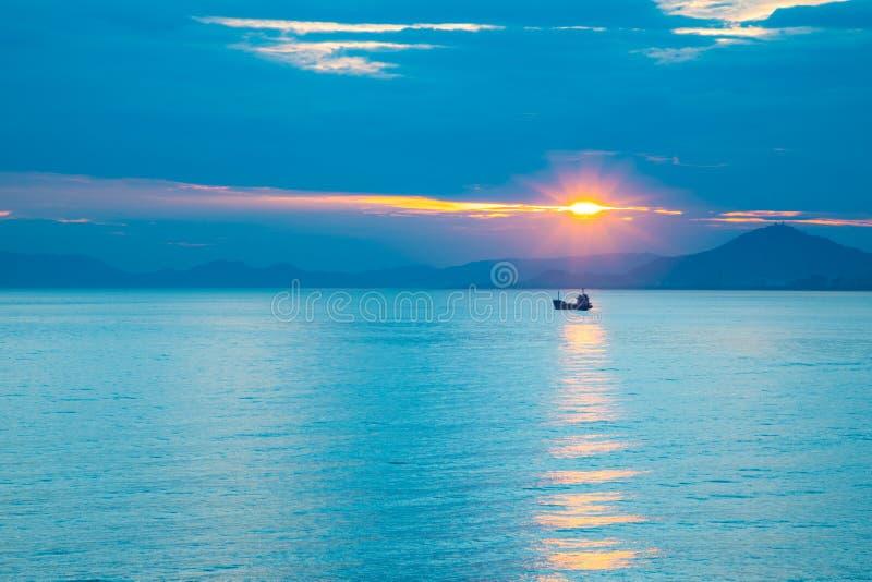Fishing boat on sea in sunset lights in Sanya, Hainan, China stock photo