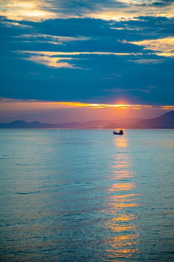 Fishing boat on sea in sunset lights in Sanya, Hainan, China royalty free stock photo