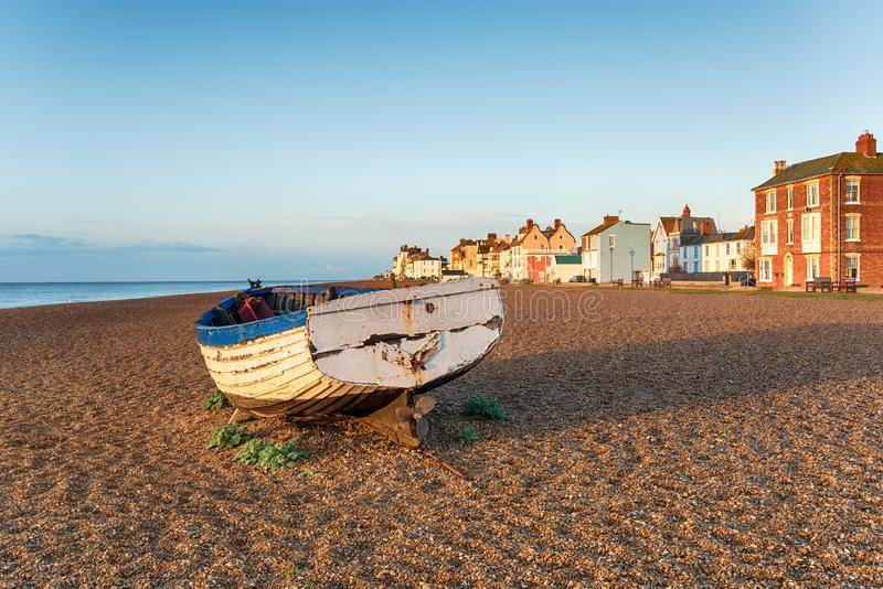 A fishing boat on a shingle beach at Aldeburgh. On the coast of Suffolk royalty free stock photography