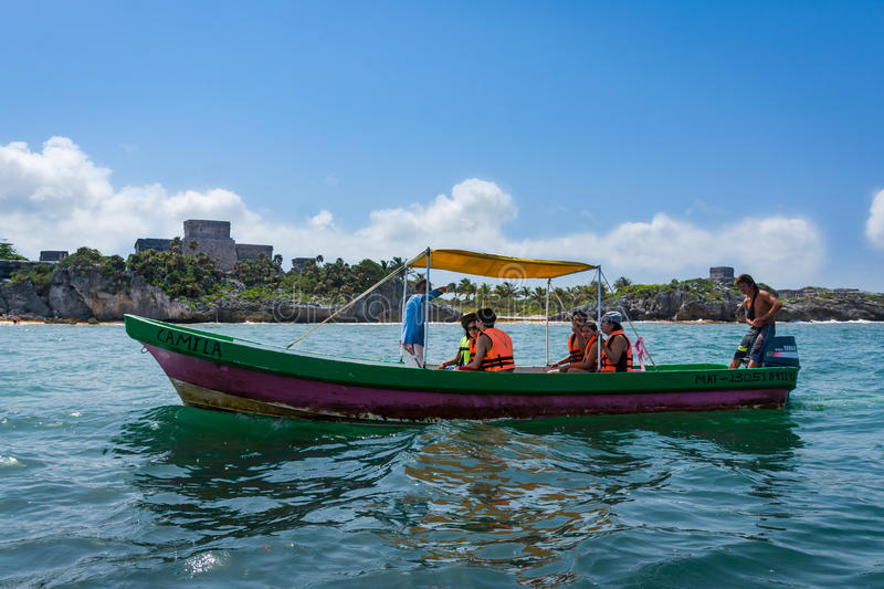 Fishing boat snorkel tour of Tulum Mexico Beach paradise. Boat tour of a Tropical beach paradise in Tulum Mexico with the ancient Myan ruins visible in the royalty free stock photography