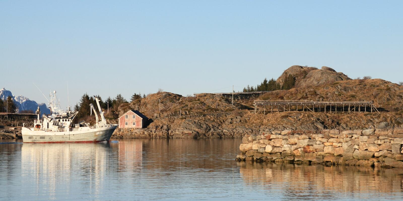 Fishing Boat  And Stockfish Racks Royalty Free Stock Image