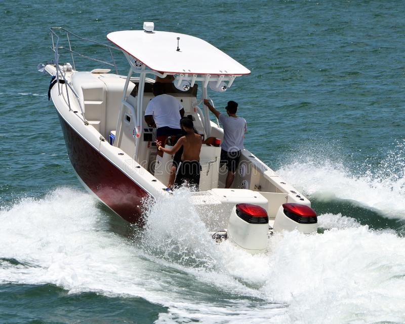 Fishing Boat on a Sunday Afternoon Pleasure Cruise. Fishing boat powered by two outboard engines taking passengers for a Sunday afternoon pleasure cruise on the stock images