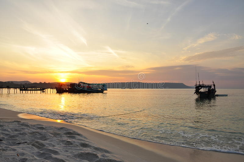 Koh Rong island, Cambodia. Beach and fishing boat at sunrise stock photos