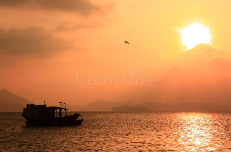 Fishing boat in sunset, Hong Kong.