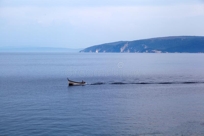 Fishing boat at sunset in Istria - Croatia. Small Fishing boat at sunset in Istria - Croatia stock photo