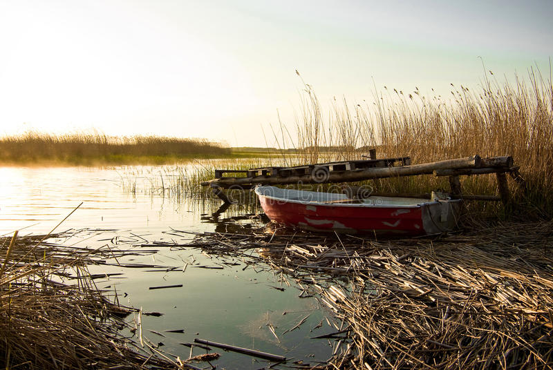 Fishing boat sunset lake stock image