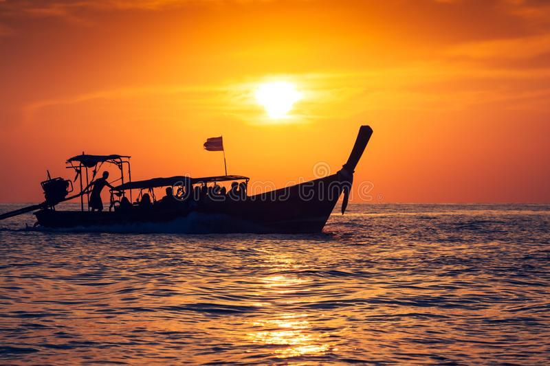 Fishing boat with sunset in phi phi islands,Thailand royalty free stock photography