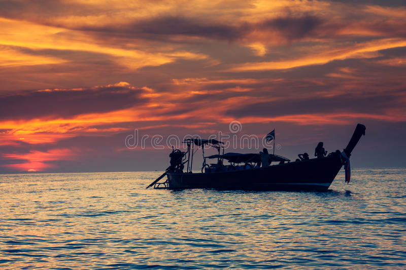 Fishing boat with sunset in phi phi islands,Thailand royalty free stock images