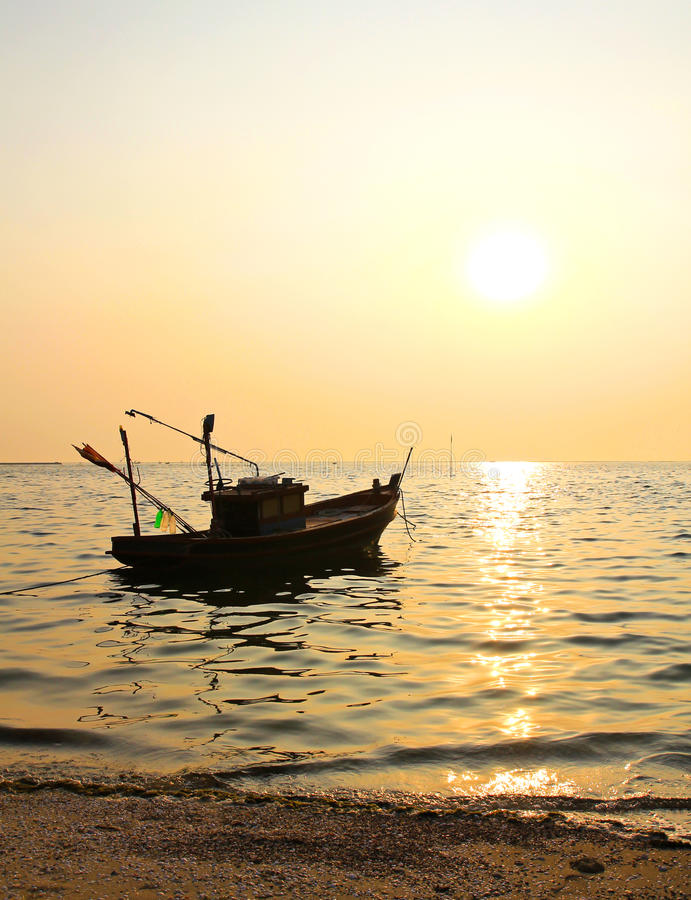 Fishing boat at sunset stock photography