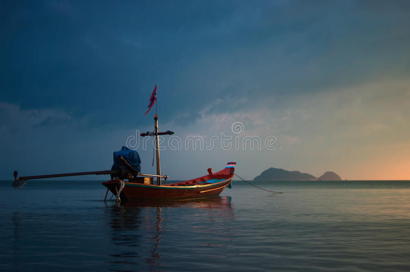 Fishing boat at sunset. In the tropical sea stock photo