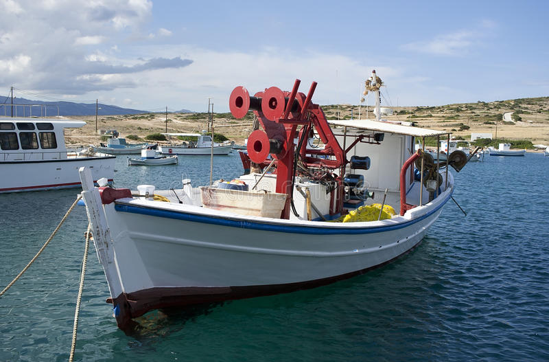 Fishing boat. Traditional greek fishing boat on the port stock image