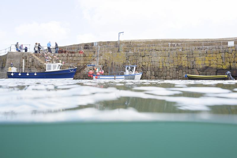 Fishing boat trip from Mousehole Harbour royalty free stock images