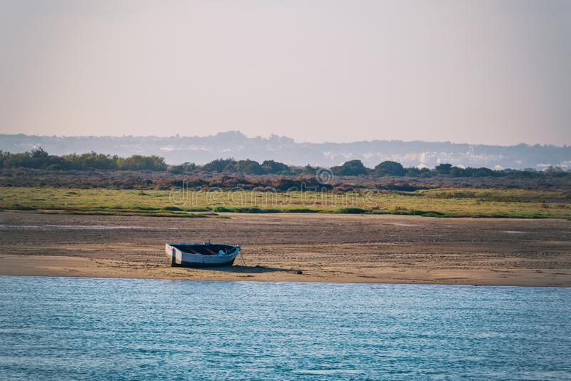 Fishing boat waiting for the tide to rise royalty free stock images