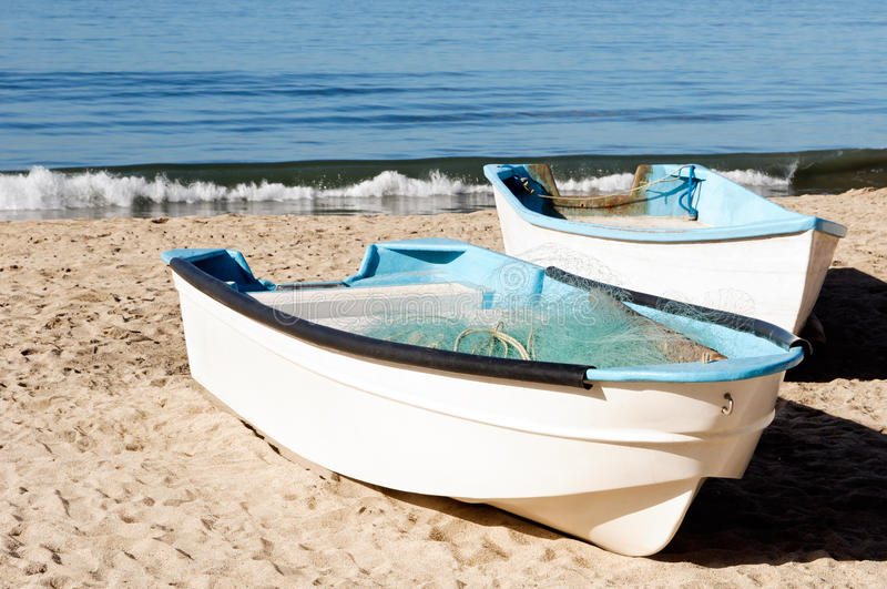 Fishing Boats. On the sand in Mexico stock photography