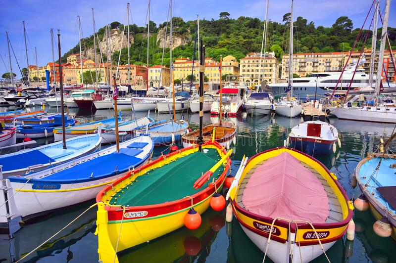 Fishing boats along the French Riviera on the Mediterranean Sea at Nice, France. Nice, France - June 11, 2019 - Fishing boats docked in the port along the French royalty free stock photo