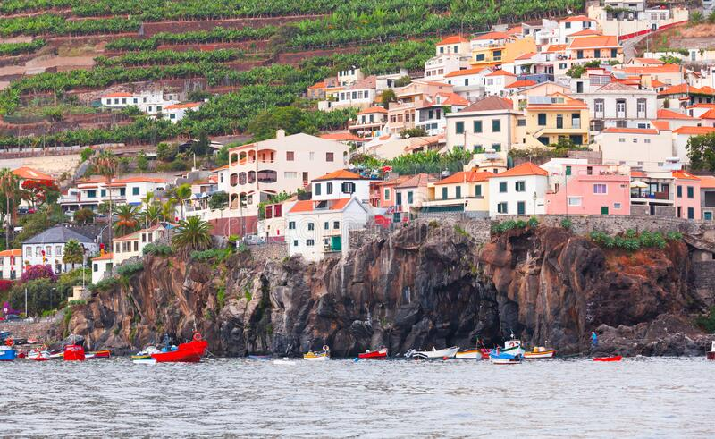 Fishing boats anchored near rocky coast. Madeira royalty free stock images