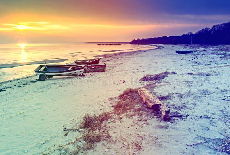 Fishing boats anchored at sandy beach of the Baltic Sea, Latvia royalty free stock photography