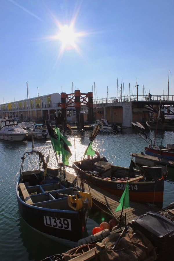 Fishing boats bathed in the Winter sun marina stock photo